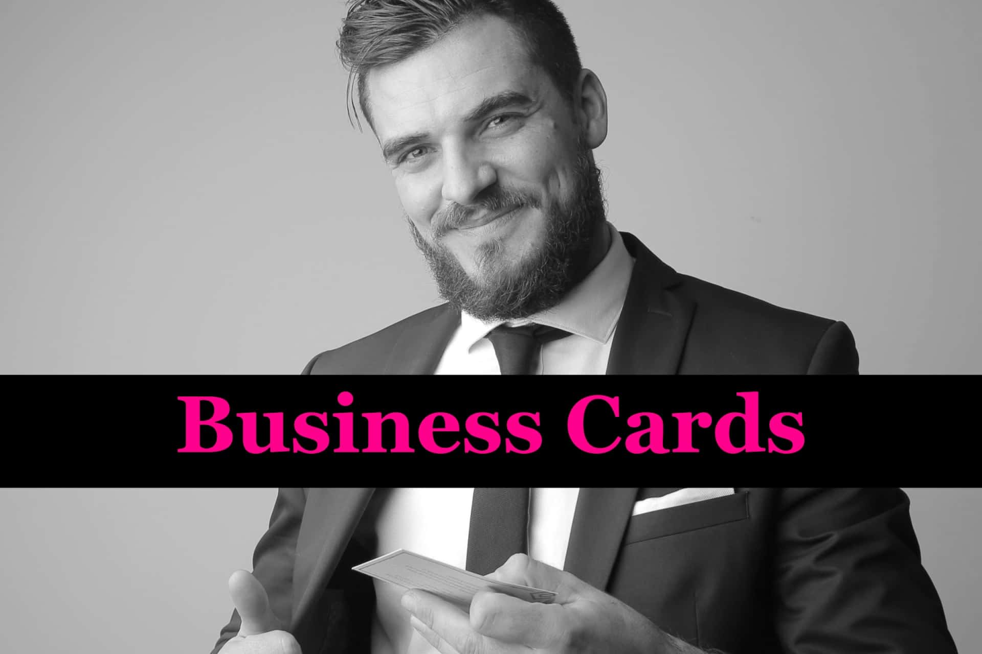 Smiling business man holding his business cards