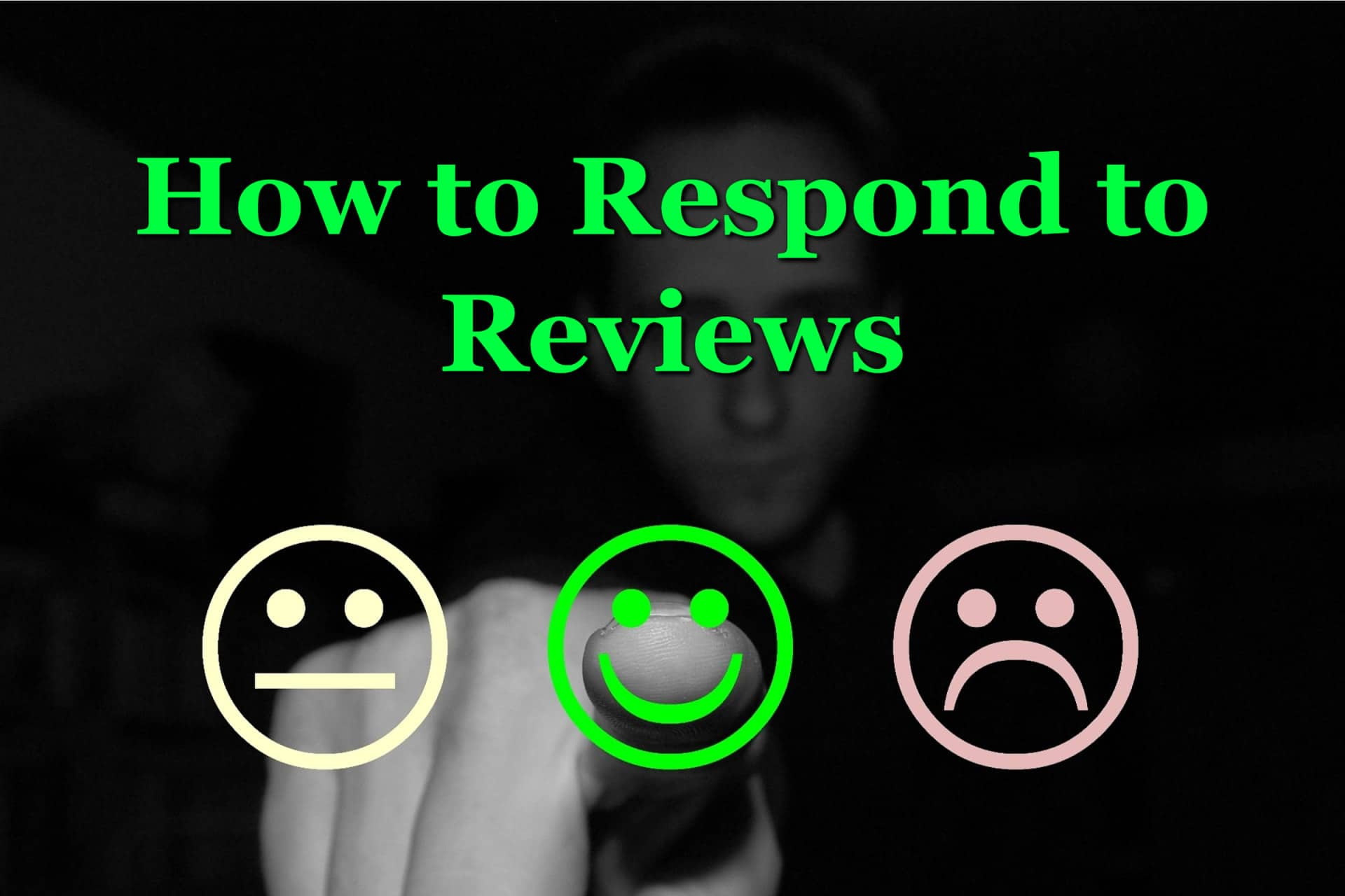 A man who understands how to respond to reviews who is pointing at a smiley face.